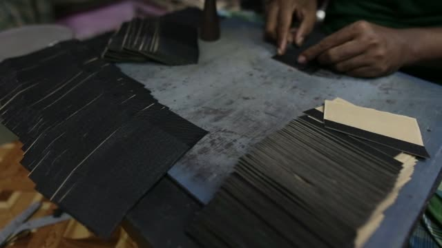 close up a worker manufactures wallets at a leather workshop in the dharavi area of mumbai india on tuesday july 18 close up cut pieces of leather... - animal skin stock videos & royalty-free footage