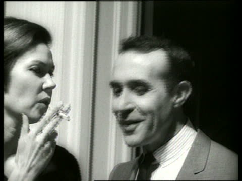B/W close up actor Ricardo Montalban speaking with woman / 1960's / SOUND