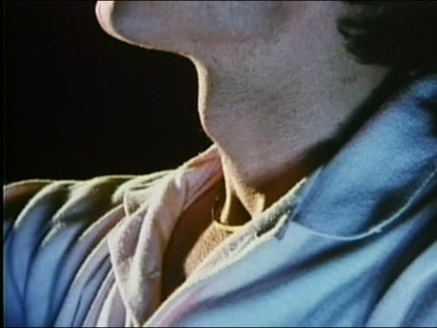 1987 close up Adam's apple going up and down during swallowing