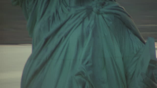 close up aerial around statue of liberty at twilight - statue of liberty new york city stock videos and b-roll footage