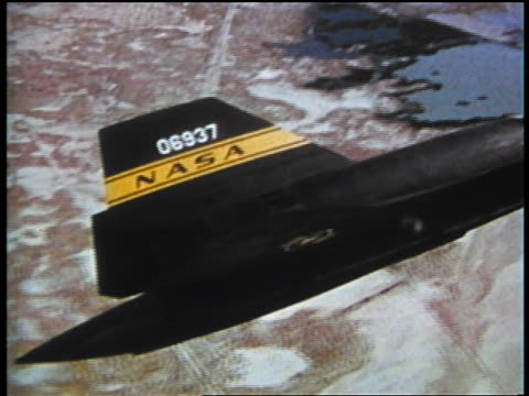 1973 close up aerial pan from tail to nose of yf-12 flying over desert (prototype for sr-71 blackbird) - military aeroplane stock videos & royalty-free footage