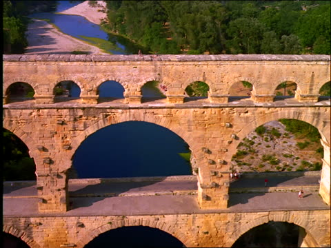close up aerial over aqueduct ruins with people / pont du gard / provence, france - arch bridge stock videos and b-roll footage