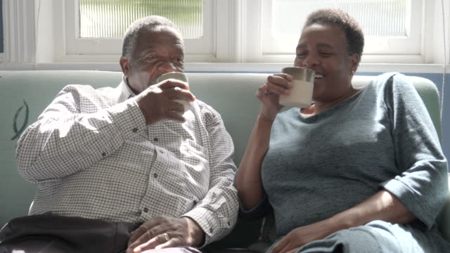 close up, african american couple sip hot chocolate - drinking stock videos & royalty-free footage