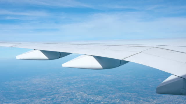 close up airplane wing when flying over city. - aircraft wing stock videos & royalty-free footage