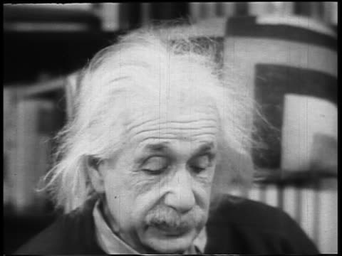 B/W 1948 close up Albert Einstein looking down reading aloud indoors