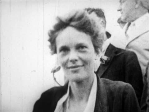 B/W 1928 close up Amelia Earhart looking around looking up outdoors / NYC / newsreel