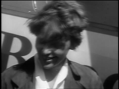 b/w 1932 close up amelia earhart smiling at camera / st john new brunswick canada / newsreel - 1932 stock-videos und b-roll-filmmaterial