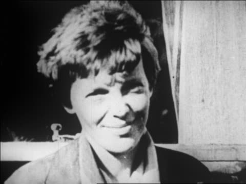 B/W 1928 close up Amelia Earhart smiling outdoors / newsreel