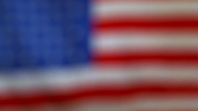 DEFOCUS close up American flag rippling