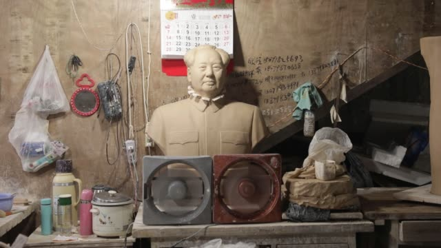 close up an unfinished bust of former chinese leader mao zedong sits inside a workshop at the jingdezhen porcelain factory in jingdezhen jiangxi... - drying rack stock videos and b-roll footage