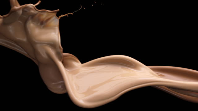 close up and slow motion of 2 cream foundation colored liquids flowing and colliding in air with splash against a black background - liquid stock videos & royalty-free footage