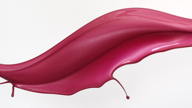 close up and slow motion of pink colored glossy cosmetic liquid flowing and throwing in air with splash against a white background - femininity stock videos & royalty-free footage
