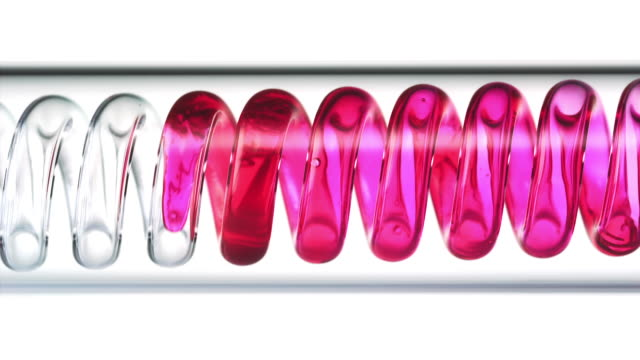 vidéos et rushes de close up and slow motion of pink red liquid spiraling horizontally from right to left in a scientific glass condenser - red