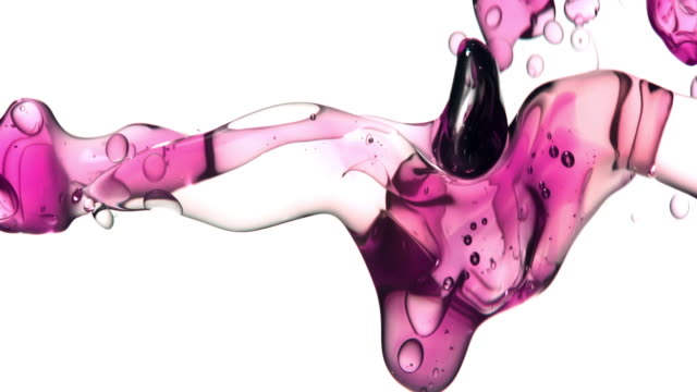 close up and slow motion of pouring pink hued oil from right and creating a row of bubbles under water while bouncing around on white background - chemistry stock videos & royalty-free footage