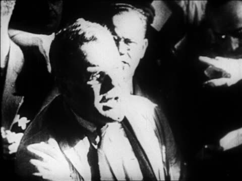 close up angry trader holding up hands + yelling on floor of stock exchange / newsreel - 1929 stock videos & royalty-free footage
