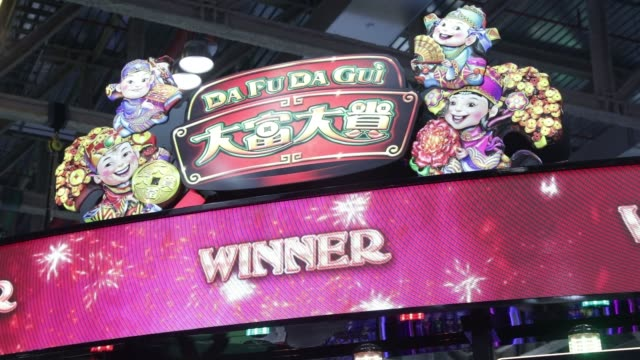 close up, animation of fireworks with the word winner displayed above a slot machine at the global gaming expo inside the venetian macau resort and... - macao stock videos & royalty-free footage