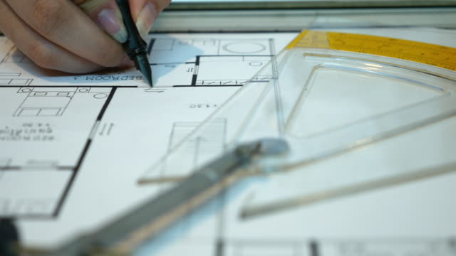 Close up architect builder woman drawing blueprints, 4K(UHD)