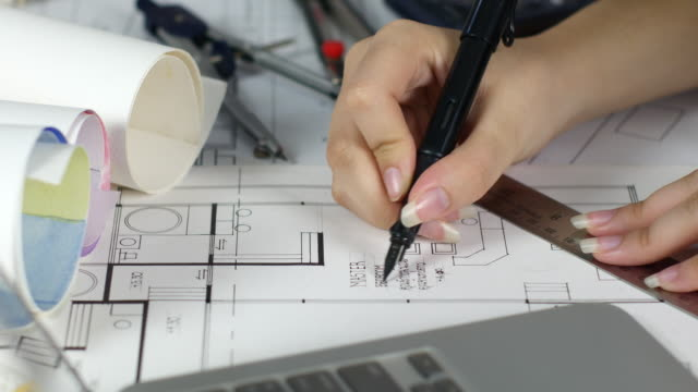 close up architect drawing on blueprints - business finance and industry stock videos & royalty-free footage