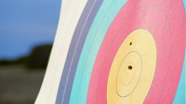 close up arrow hitting bullseye target - sports target stock videos and b-roll footage