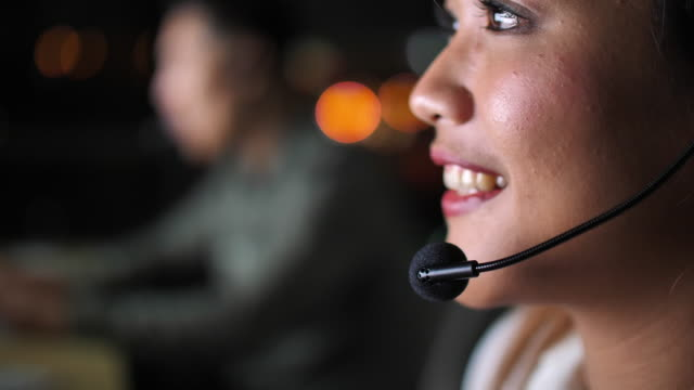 close up asia call center at night - rescue services occupation stock videos & royalty-free footage