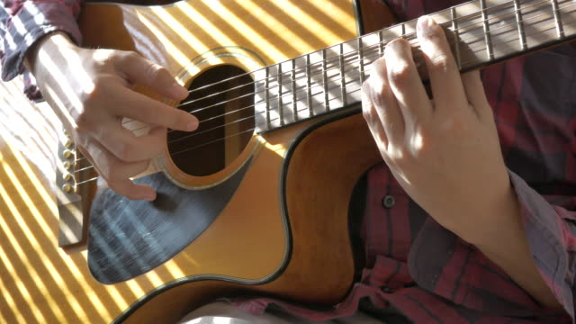 close up asian man playing guitar for relaxation on bed, concept day in the life fever covid-19 quarantine - day in the life stock videos & royalty-free footage