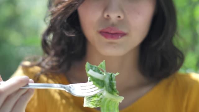close up asian woman eating salad - salad stock videos & royalty-free footage