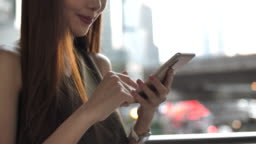 Close up asian woman using phone