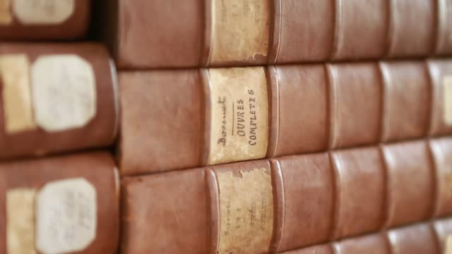 close up at the book covers in the xavier center of historical research founded by the jesuits - christian ender stock-videos und b-roll-filmmaterial