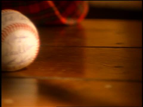 close up pan autographed baseball on table - お土産点の映像素材/bロール