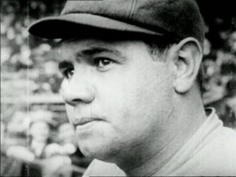 b/w 1927 close up babe ruth in baseball cap talking / newsreel - baseballmütze stock-videos und b-roll-filmmaterial