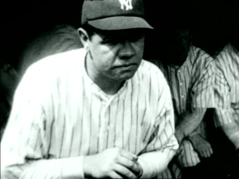 close up babe ruth in yankee uniform sitting in front of dugout / documentary - anno 1925 video stock e b–roll
