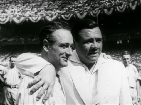 B/W 1939 close up Babe Ruth with arm around Lou Gehrig in crowded stadium / Gehrig's farewell