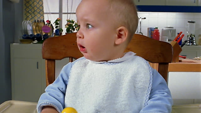 close up baby in high chair / zoom out businessmen staring at baby - confusion stock videos and b-roll footage