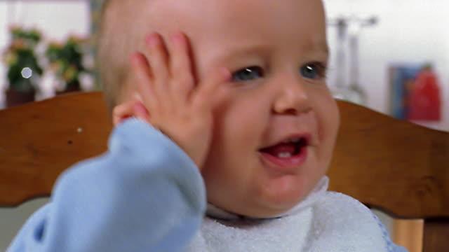 close up baby playing with toy - okänt kön bildbanksvideor och videomaterial från bakom kulisserna