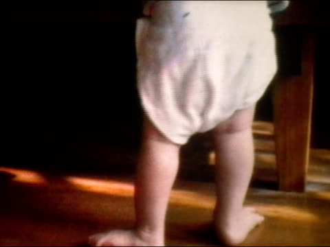 1972 close up baby wearing saggy cloth diaper - nappy stock videos and b-roll footage