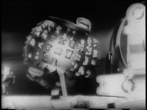 b/w 1961 close up ball with type on it spinning + hitting ribbon in typewriter / newsreel - 1961 stock videos & royalty-free footage