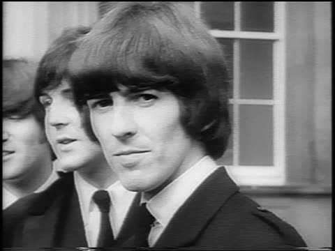 close up beatles posing for cameras outside of buckingham palace / london / newsreel - ringo starr stock videos & royalty-free footage