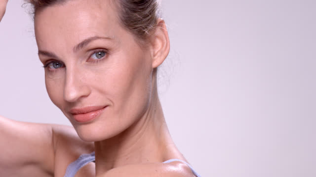 close up beautiful mature woman with flawless skin. - anti aging stock videos & royalty-free footage