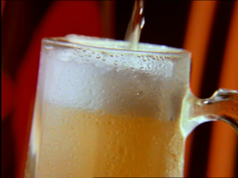 close up  beer being poured into mug