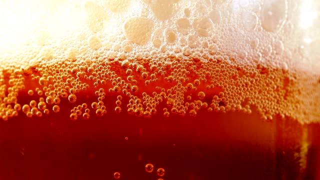 Close up beer glass with bubbles