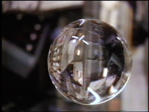 close up big bubble with reflection of astronaut Eileen Collins floating in space shuttle / STS84
