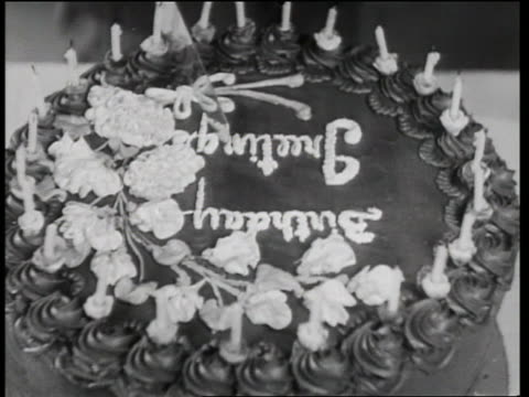 b/w 1933 close up birthday cake explodes as knife cuts into it / in the dough - 1933 stock videos & royalty-free footage