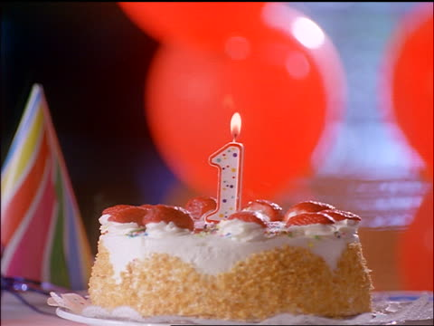 """close up birthday cake with """"1"""" candle being blown out - birthday cake stock videos & royalty-free footage"""