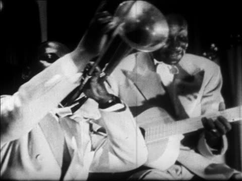 b/w 1928 close up black man in band playing trombone / newsreel - jazz music stock videos & royalty-free footage