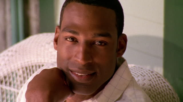 close up black man smiling - one mid adult man only stock videos & royalty-free footage