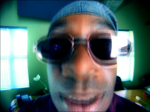close up black man with sunglasses making faces at camera - fish eye lens stock videos & royalty-free footage
