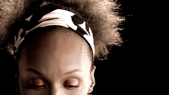 close up PAN black woman making various expressions