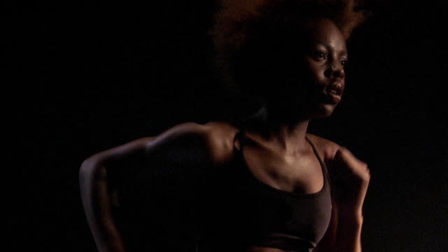 close up black woman running - only women stock videos & royalty-free footage