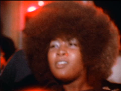 1974 close up Black woman with afro dancing at party indoors / documentary