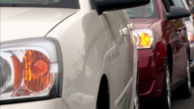 close up blinking hazard lights on cars in traffic jam - vehicle breakdown stock videos & royalty-free footage